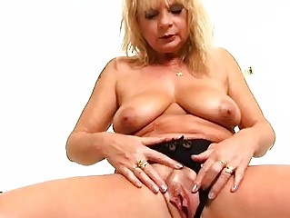 Aged blonde Rosalyn plays with herself in the shower - Trion Media
