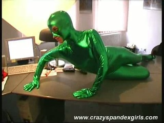 Green spandex catsuit wearing blond strips down to  pussy