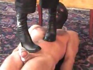 Headmistress in high heels walks on him