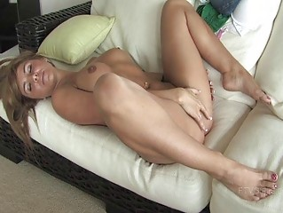 Patricia naughty redhead girl fingering pussy on the couch