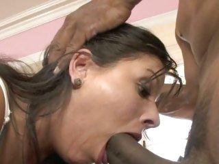 Filthy brunette chokes on a massive dark fuck shaft