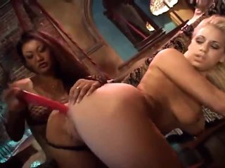 Intense lesbo three-some with dildo play