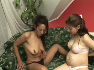 Hot Babe Loving Her Lesbian Lover's Pregnant Pussy