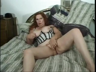 Chubby milf redhead in bustier goes black