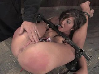 The doxy was tied down as her slit was pushed with fingers and toys