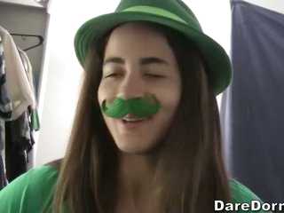 College girls and guys celebrate St. Patrick's Day. They have the all-in-green party. This amateur video features them doing wild things for entertainment.