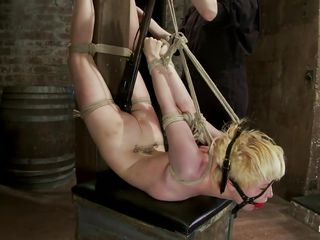 tied blonde receives a spank on her ass