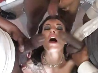 White chocolate babe with tattoo plays with darksome dicks in gang bang