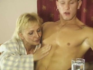 Older blonde pounded on her dining room table