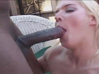 Shaved girl gets a dark rod up her butt
