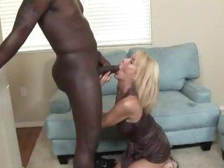 Skinny brunette sucks a monster black cock